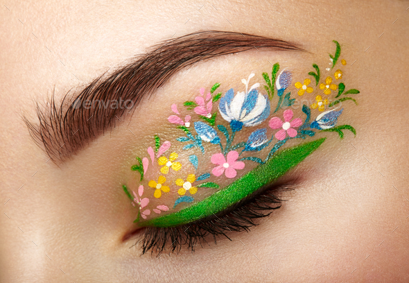 Eye makeup girl with a flowers - Stock Photo - Images
