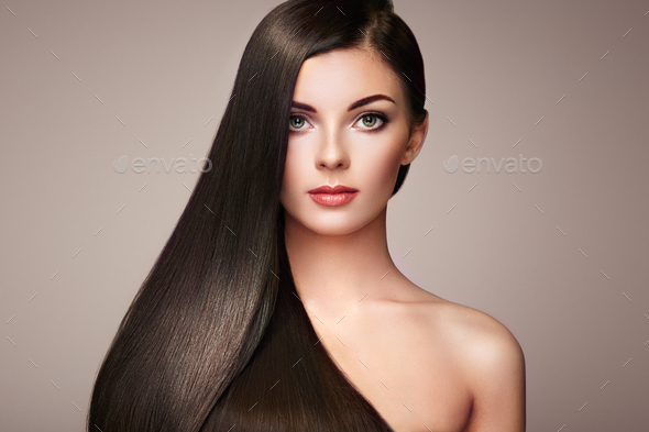 Beautiful woman with long smooth hair - Stock Photo - Images