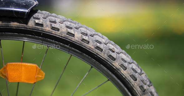 Old bicycle wheel - Stock Photo - Images