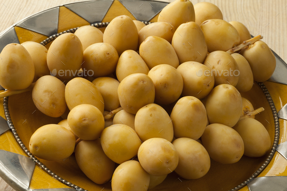 Bunch of fresh yellow dates - Stock Photo - Images