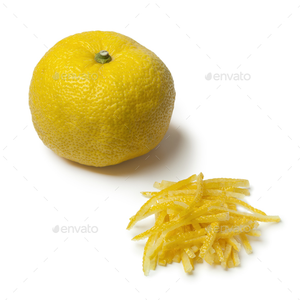 Fresh strips of a yellow Japanese Yuzu skin - Stock Photo - Images
