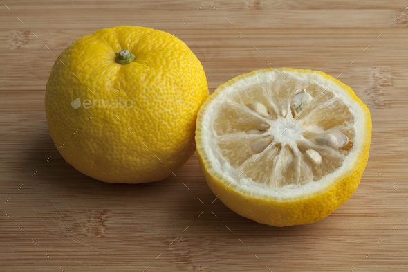 Fresh yellow whole and half Japanese Yuzu fruit - Stock Photo - Images