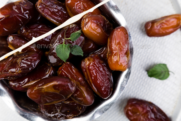 Dry fruit dates on silver tray. Copy space. Top view. - Stock Photo - Images