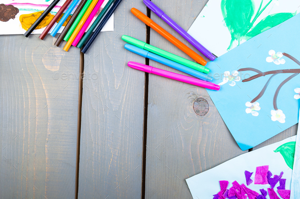 Child pictures. Kid drawings. Flat lay. Copy space. - Stock Photo - Images