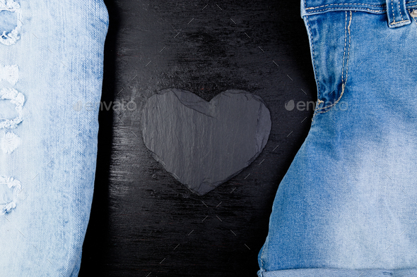 Denim. Jeans texture background. Valentine Day. Black Stone Slate heart. Copy space. - Stock Photo - Images
