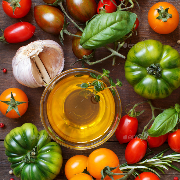 Colorful tomatoes, garlic, olive oil and herbs - Stock Photo - Images