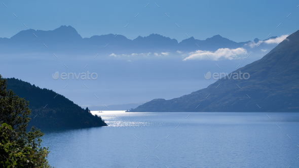 Blue Haze over Lake Wakatipu and Remarkables Mountains - Stock Photo - Images