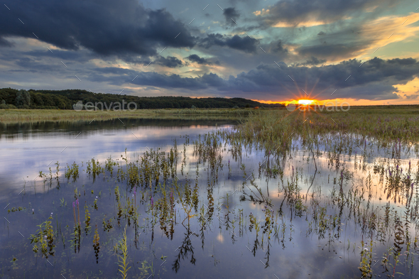 Dark river foreland landscape image with setting sun - Stock Photo - Images