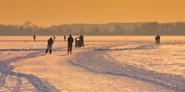 Dutch Ice Skaters under setting sun - Stock Photo - Images