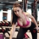 Sexy Girl with Big Breasts in Sports Clothes Doing Triceps Exercises. Sports Girl Doing Exercises - VideoHive Item for Sale