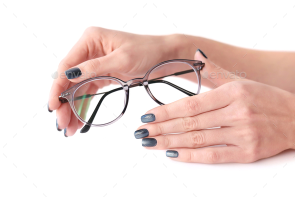 Female hands holding eye glasses on white background - Stock Photo - Images