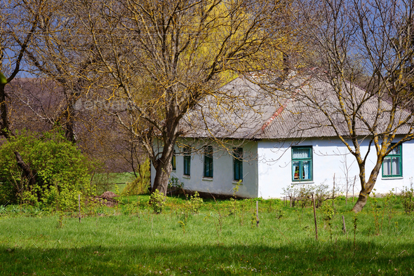 Old traditional ukrainian rural cottage in sunlight of spring - Stock Photo - Images