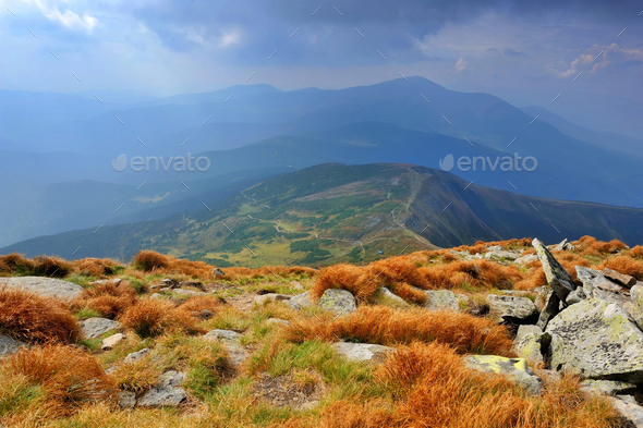 Fantastic mountain landscape. Autumn, dramatic sky with clouds. - Stock Photo - Images