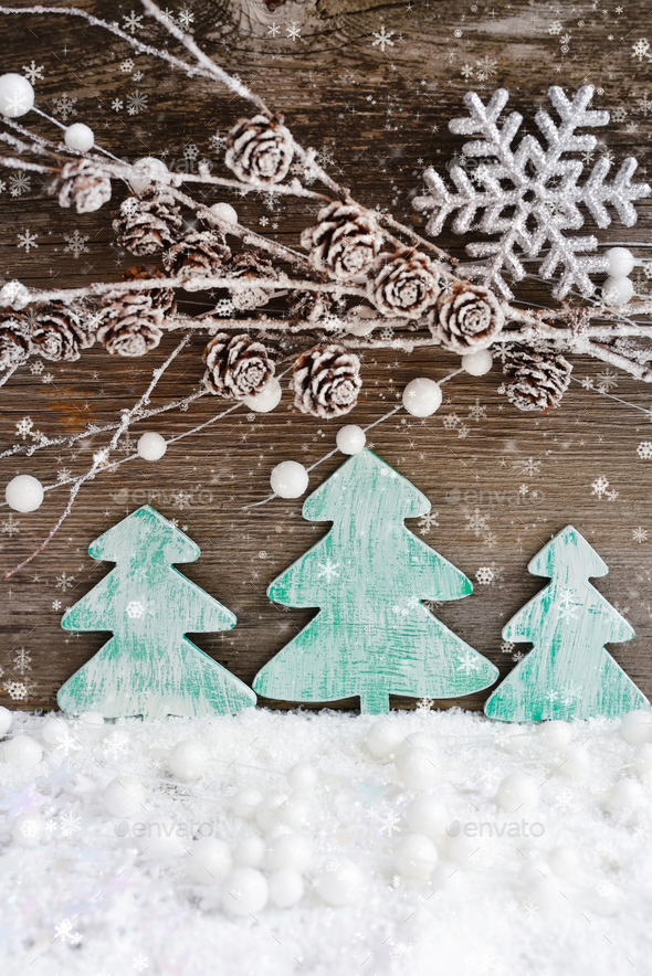 Christmas card with wooden christmas trees on the snow on a wood - Stock Photo - Images
