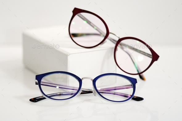 Multicolored fashionable glasses with white case - Stock Photo - Images