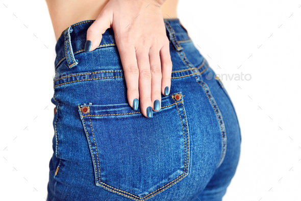 Young girl in jeans with blue manicure. Focus on the hand. - Stock Photo - Images