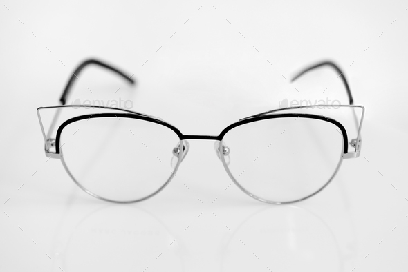Eye glasses with clear lenses on the white background - Stock Photo - Images