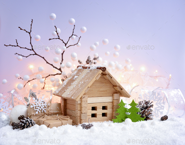 Christmas decorative landscape with toy house in snow, gifts and - Stock Photo - Images