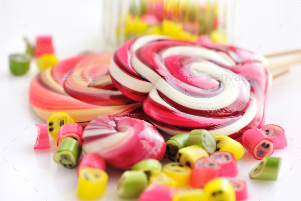 Colorful candies and lollipops on a white background - Stock Photo - Images