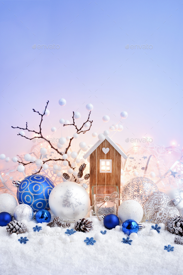 Christmas composition with decorative balls and toy house on sno - Stock Photo - Images