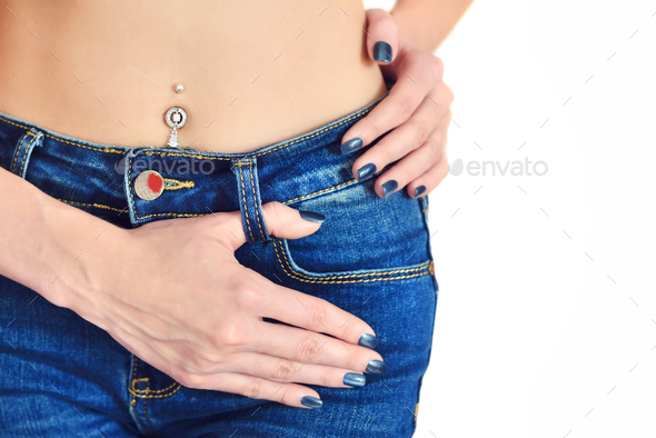 Young girl in jeans with blue manicure. Focus on the hand. Copy - Stock Photo - Images