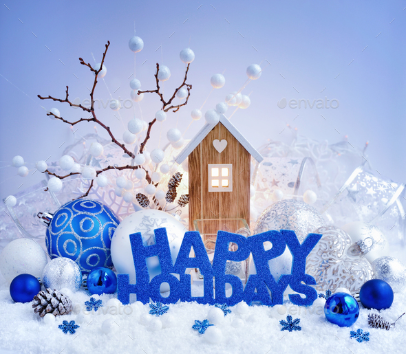 "Greeting ""Happy Holidays"", decorative balls and toy house on a b - Stock Photo - Images"