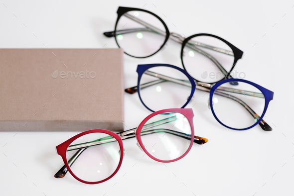 Multicolored fashionable glasses with box on white background - Stock Photo - Images
