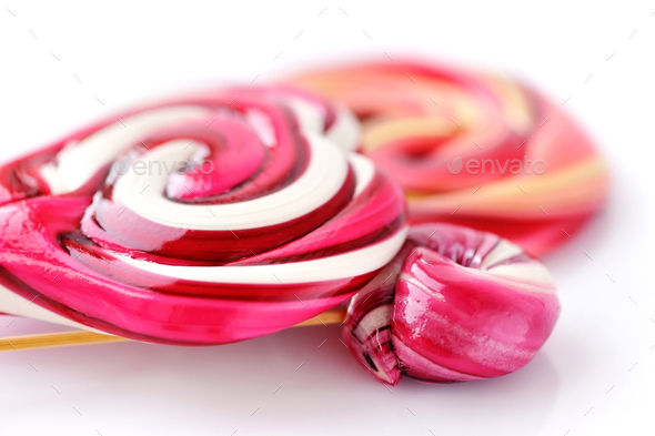 Colourful sweet lollipops on white background - Stock Photo - Images