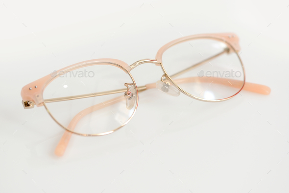 Pink glasses with clear lenses on the white background - Stock Photo - Images