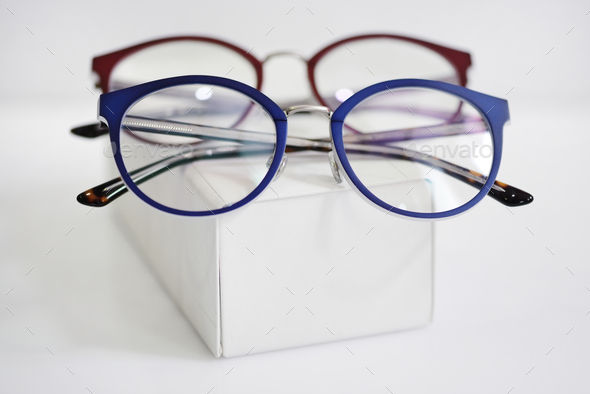 Multicolored fashionable glasses on a white case - Stock Photo - Images