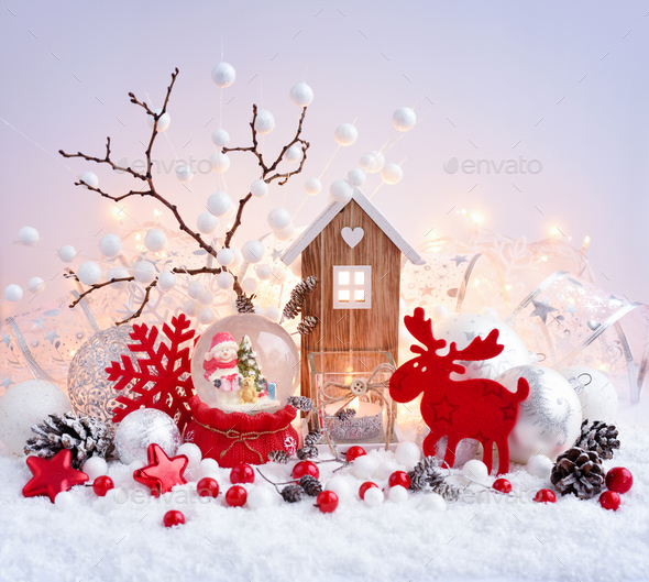 A snow globe with snowman with christmas decorations and toy hou - Stock Photo - Images