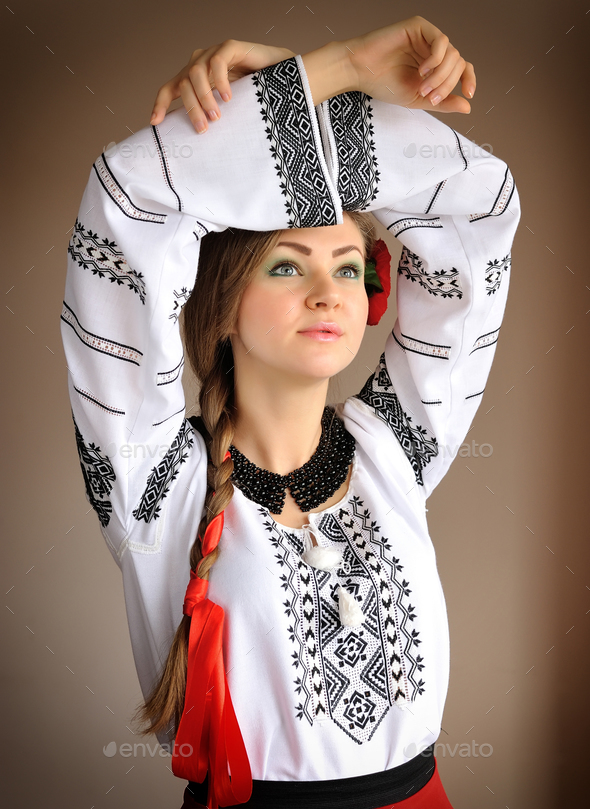 Beautiful young girl in a white embroidered blouse. Girl in Ukra - Stock Photo - Images