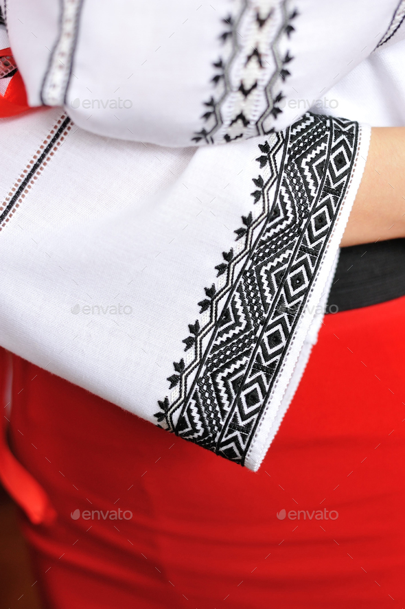 The girl in an embroidered shirt. Closeup pattern on the sleeve. - Stock Photo - Images