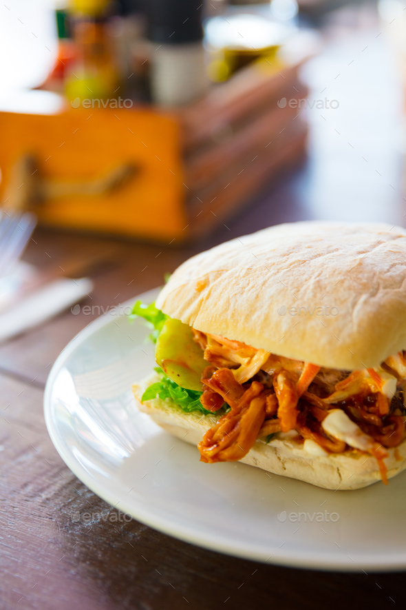 Fresh Pulled Pork Burger Served On Restaurant Table - Stock Photo - Images