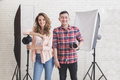 two young photographer in studio with lighting at the background - PhotoDune Item for Sale