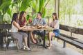group of four best friend having their lunch together at a cafe - PhotoDune Item for Sale