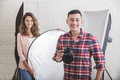 young photographer with his beautiful assistant in studio - PhotoDune Item for Sale