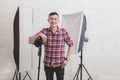 Young photographer with camera in professionally equipped studio - PhotoDune Item for Sale