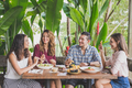 group of four best friend having fun conversation while lunch to - PhotoDune Item for Sale
