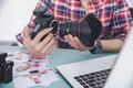 hands of photographer attaching the camera lens to camera body - PhotoDune Item for Sale