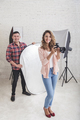 young beautiful photographer with her assistant in studio ready - PhotoDune Item for Sale