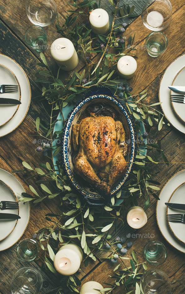 Flat-lay of whole roasted chicken for Christmas over table background - Stock Photo - Images