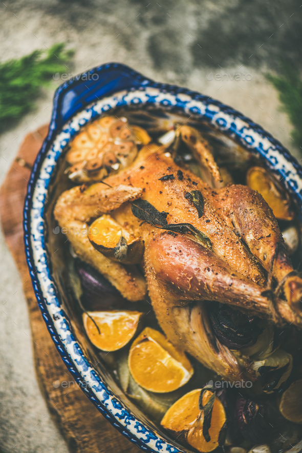 Roasted whole chicken with orange for Christmas eve celebration table - Stock Photo - Images