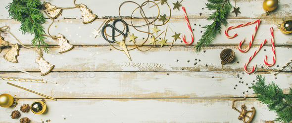 Holiday decoration toys, candles, rope, garlands, tree branches, candy cane - Stock Photo - Images
