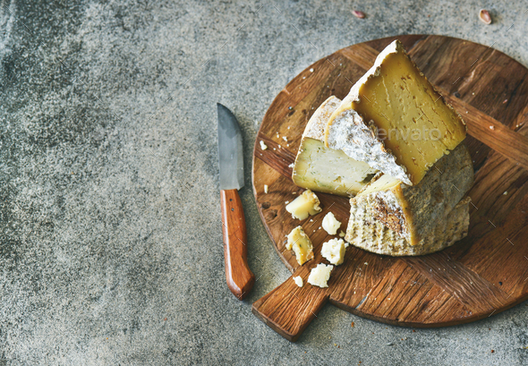 Cheese assortment on board, copy space - Stock Photo - Images