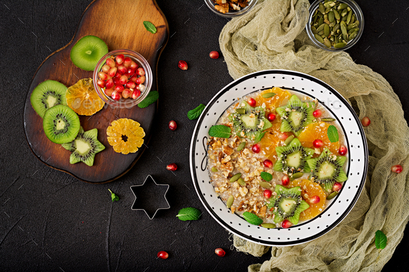 Tasty and healthy oatmeal porridge with fruit, berry and nuts. - Stock Photo - Images