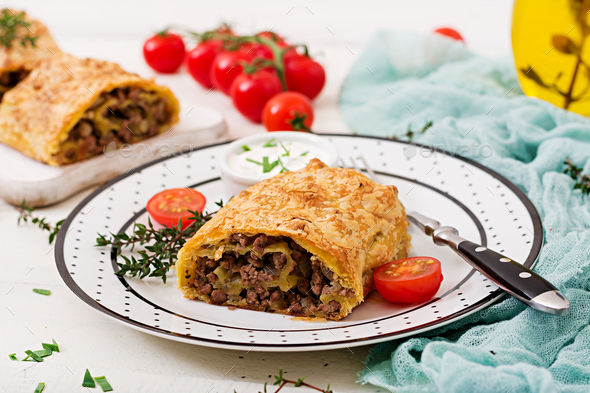 Appetizing strudel with minced beef, onions and herbs - Stock Photo - Images