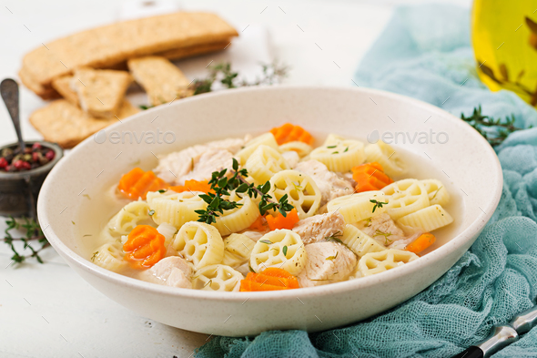 Dietary soup with turkey or chicken fillet with pasta Ruote and herbs - Stock Photo - Images