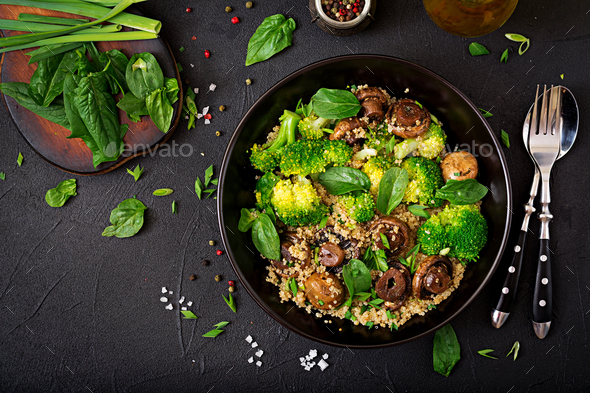 Healthy vegan salad of vegetables - broccoli, mushrooms, spinach and quinoa - Stock Photo - Images