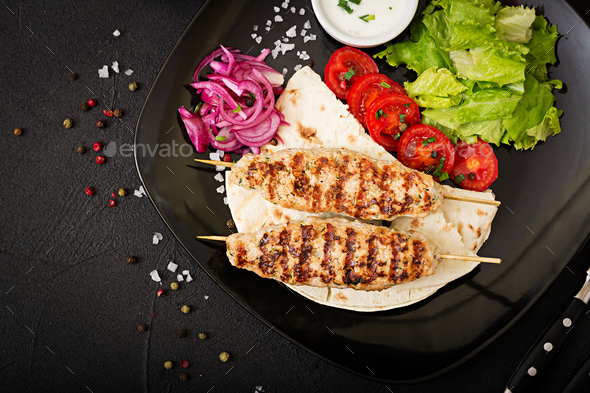 Minced Lula kebab grilled turkey (chicken) with fresh vegetables. Top view - Stock Photo - Images